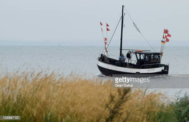 Veteran fishermen Klaus Raack and Reinhard Lay take their fishing boat into the Baltic Sea to lay their fishing nets on August 12 2010 near...