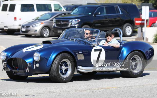 Veteran French rocker Johnny Hallyday steps out for lunch with French singer Maxim Nucci aka Yodelice in Malibu California on March 9 2017 / AFP...