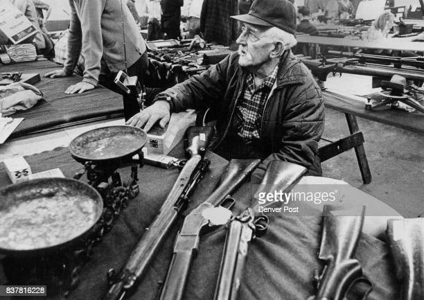 Veteran Gun Collector Watches Proceedings at Arapahoe Show George Ellis 5200 Balsam St Arvada sits by one of his scales that is estimated to be well...
