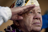 Veteran Howard Snell salutes the American Flag during a memorial service for 69th anniversary of the attack on the US naval base at Pearl Harbor on...