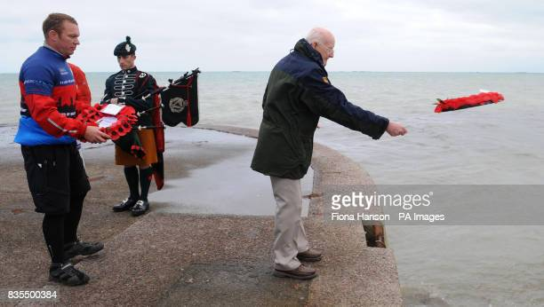 WWII veteran John Painter throws a Help for Heroes wreath from the promenade at Arromanches where 65 years ago he landed a month after Dday...