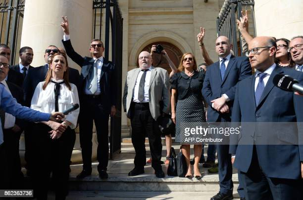 Veteran lawyer and blogger Andrew Borg Cardona accompanied by members of the Parliament and lawyers stand outside the law court in Valletta Malta on...