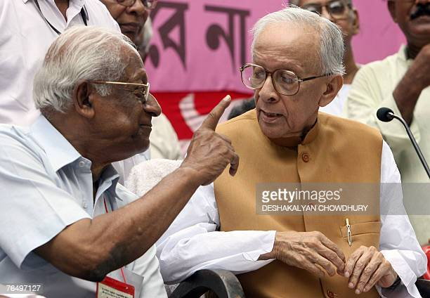 Veteran leader of the Communist Party of India Jyoti Basu listens to Communist leader A B Bardhan during a flag off ceremony for a 'Jatha' in Kolkata...