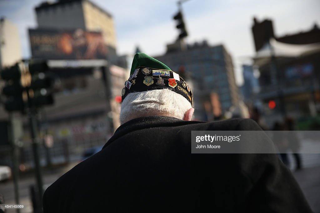A veteran leaves a ceremony marking the 72nd anniversary of the attack on Pearl Harbor, Hawaii on December 7, 2013 in New York City. Four Pearl Harbor survivors from the New York area gathered with former crew members of the USS Intrepid to mark the Japanese surprise attack on December 7, 1941 which killed 2,402 Americans and brought the United States into WWII.