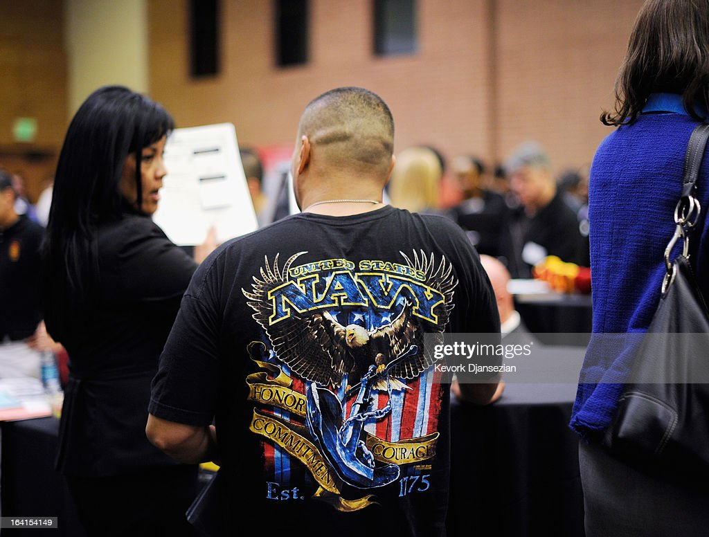 A veteran listens to a speaker as he looks at job openings at the University of Southern California booth during a jobs fair for veterans called 'Serving Those Who Have Served' on the campus of University of Southern California on March 20, 2013 in Los Angeles, California. California's unemployment rate tied with Rhode Island's for highest in U.S. at 9.8 percent.
