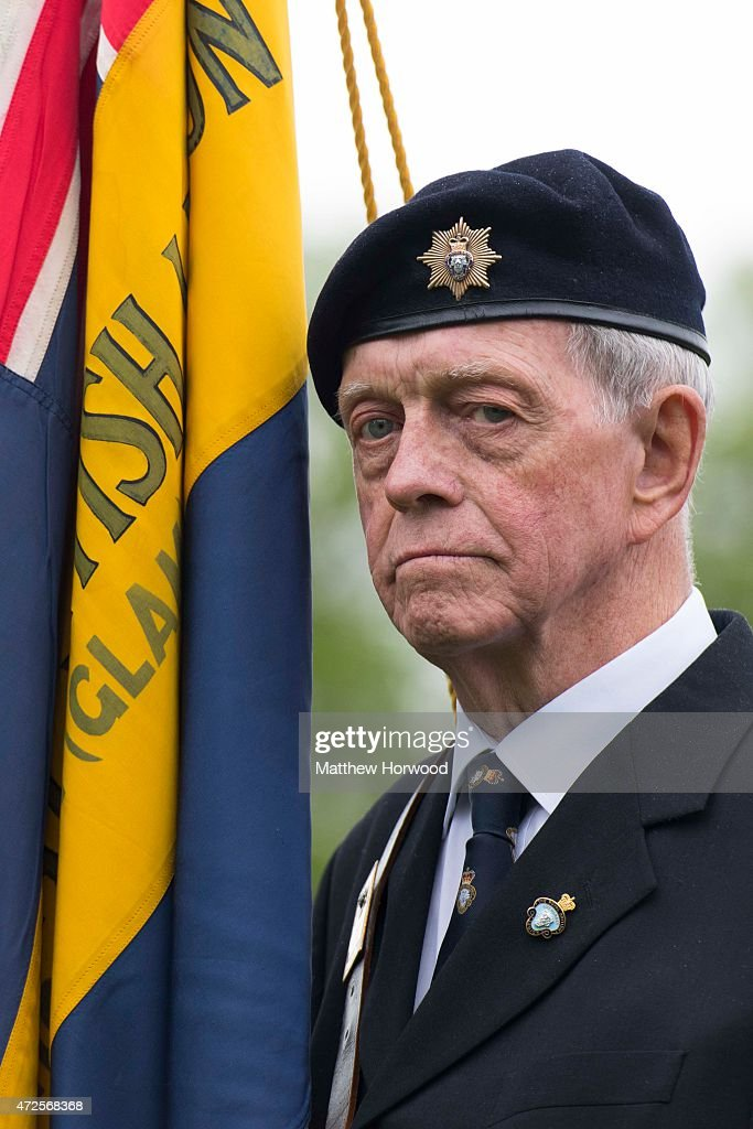 A veteran looks on during a service at Cardiff Castle to mark the 70th anniversary of VE Day on May 8, 2015 in Cardiff, Wales. Great Britain now starts three days of national commemorations of street parties, concerts and other events across the country to remember the end of World War II in Europe.