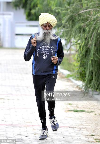 Veteran Marathon runner Fauja Singh poses during an exclusive interview with Hindustan Times on September 13 2016 in Jalandhar India Fauja Singh is a...