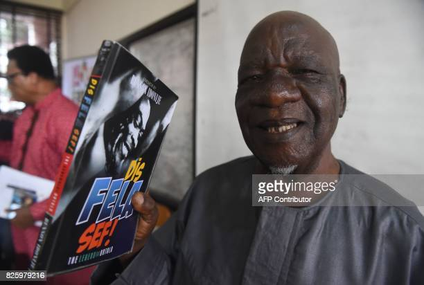 Veteran music columnist author and first manager of Nigerian musical legend Fela AnikulakpoKuti Benson Idonije speaks as he holds his book 'Dis Fela...
