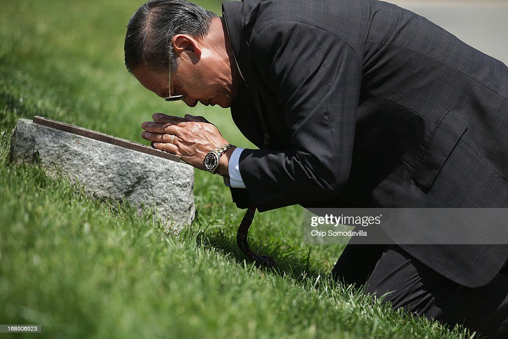 A veteran of the secret Lao Theater, Bouala Chansombath of Oklahoma City, kneels and offers a prayer at the plaque dedicated to the U.S. Secret Army in the Kingdom of Laos during a memorial and wreath-laying ceremony at Arlington National Cemetery May 10, 2013 in Arlington, Virginia. Supported by the United States and the Central Intelligence Agency from 1961 to 1973, the secret army of Hmong and Lao combat soldiers fought in the jungles of Southeast Asia during the Vietnam War.