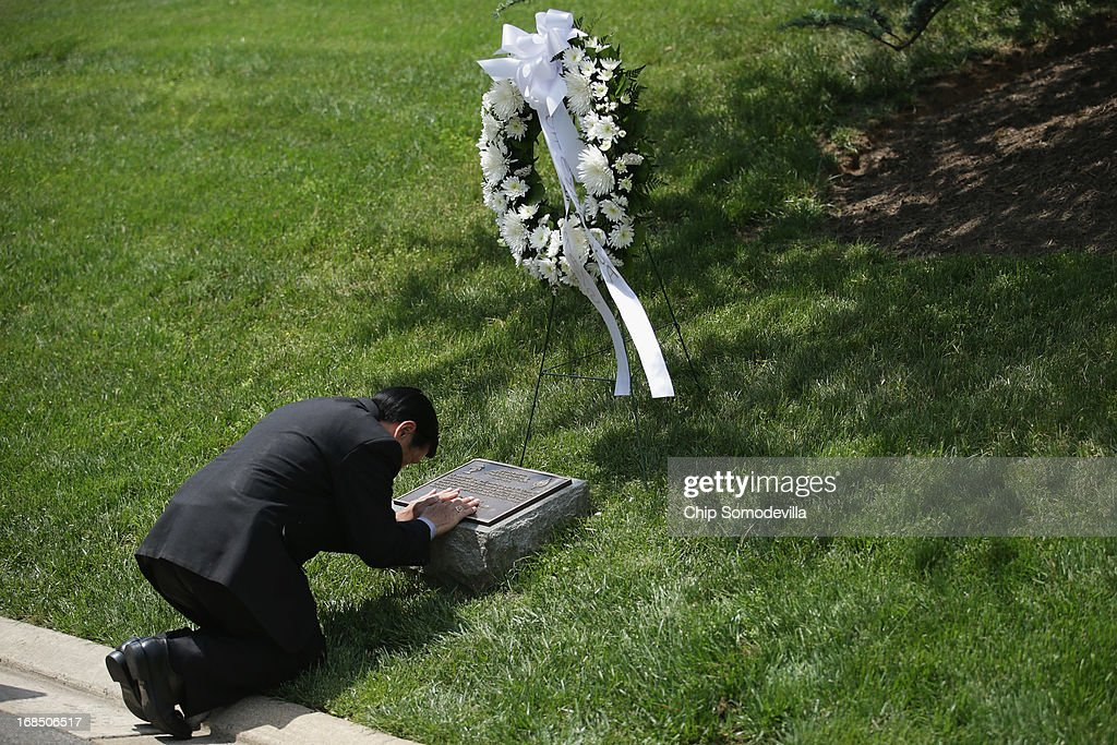 A veteran of the secret Lao Theater, Colonel Wangyee Vang, president of the Lao Veterans of America, kneels and offers a prayer at the plaque dedicated to the U.S. Secret Army in the Kingdom of Laos during a memorial and wreath-laying ceremony at Arlington National Cemetery May 10, 2013 in Arlington, Virginia. Supported by the United States and the Central Intelligence Agency from 1961 to 1973, the secret army of Hmong and Lao combat soldiers fought in the jungles of Southeast Asia during the Vietnam War.