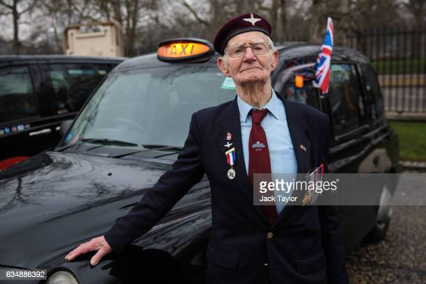 Veteran of World War II Frederick Glover is pictured in front of a black cab during a photo call for the launch of the Veterans Black Cab ride at...