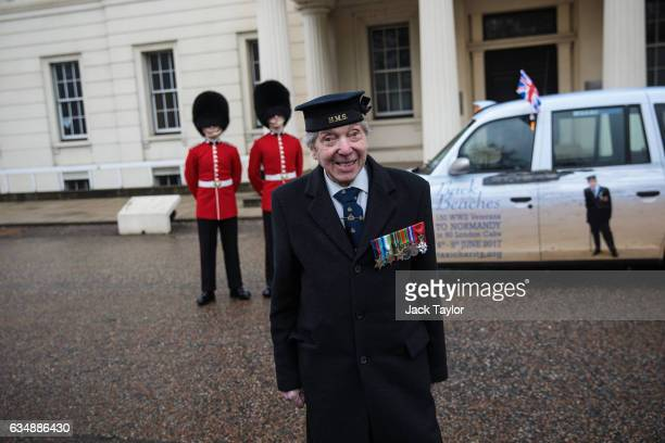 Veteran of World War II Peter Kent is pictured with guardsmen in front of a cab during a photo call for the launch of the Veterans Black Cab ride at...