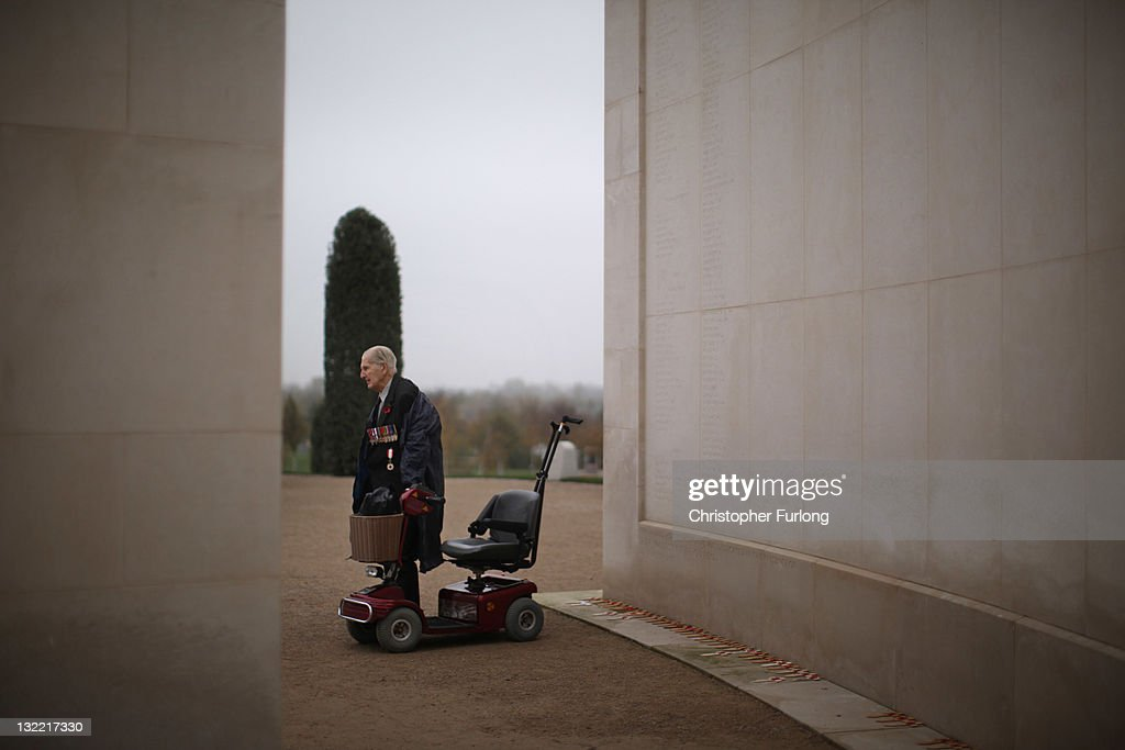 Veteran Philip Malins, aged 92, stands next to his mobility scooter as he takes part in the two minute silence at the National Memorial Arboretum on Armstice day on November 11, 2011 in Alrewas, United Kingdom. Sir James Hawley KCVO, Lord Lieutenant of Staffordshire, led the list of dignitaries at the Armed Forces Memorial during Armistice Day commemorations at the National Memorial Arboretum in Alrewas. Armistice Day traditionally marks the end of the WWI when Germany and the allied forces signed the armistice signaling the end of hostilities on the Western Front. The cessation of the war officially took effect on the eleventh hour of the eleventh day of the eleventh month and is marked annually by services of remembrance for all those who have fallen in wars and a two minute silence.
