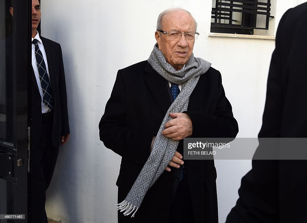 Veteran politician <a gi-track='captionPersonalityLinkClicked' href=/galleries/search?phrase=Beji+Caid+Essebsi&family=editorial&specificpeople=998512 ng-click='$event.stopPropagation()'>Beji Caid Essebsi</a>, who has claimed victory in Tunisia's first free presidential election, arrives at his party's headquarters on December 22, 2014 in Tunis. The electoral commission said it would announce official results in the evening, one day after Tunisians took to the polls for the leadership runoff vote, with many calling the ballot a landmark for democracy in the country where the Arab Spring was born. AFP PHOTO / FETHI BELAID