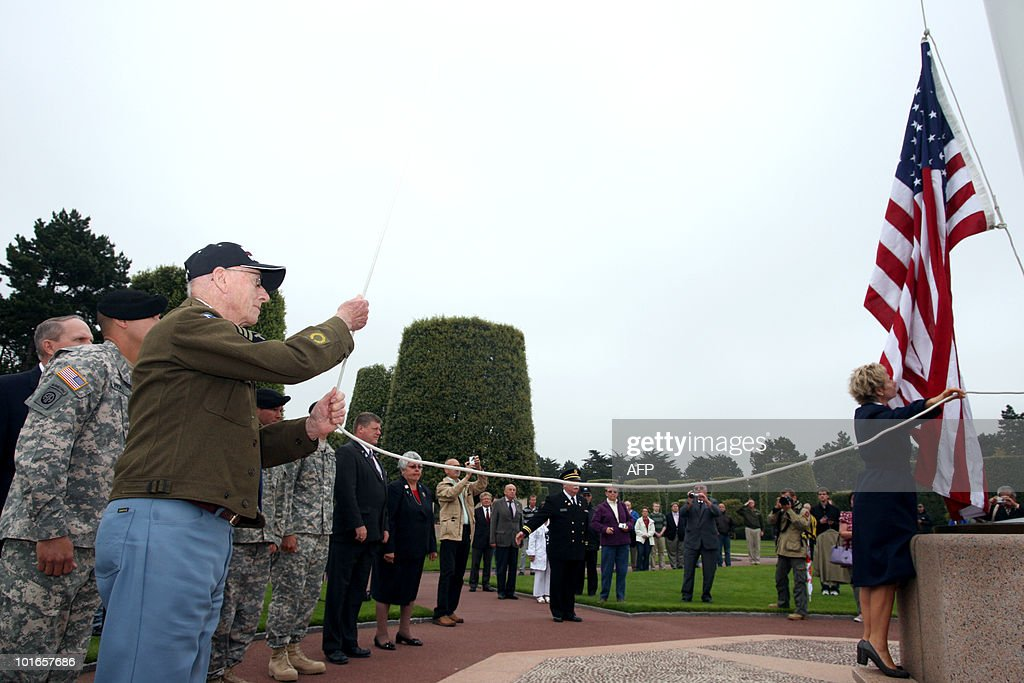 A US veteran runs up the American flag at the American cemetery in Colleville-sur-Mer, Normandy, western France, on June 6, 2010, during a commemoration of the 66th anniversary of the D-Day Allied landings on the beaches of Normandy. More than 45,000 Allied soldiers, including 29,000 Americans, were killed during Operation Overlord, which saw the opening of a second front on mainland Europe and led to the liberation of France.