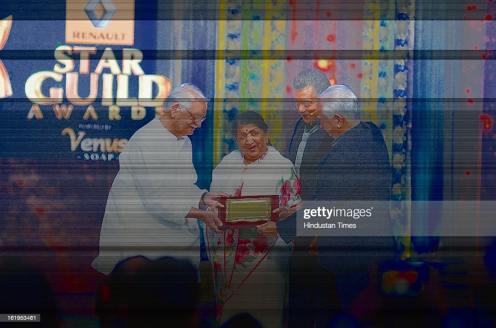 Veteran Singer Lata Mangeshkar receive Nightingale of the Century Award from Guljar, Ramesh Sippy and <a gi-track='captionPersonalityLinkClicked' href=/galleries/search?phrase=Salman+Khan+-+Actor&family=editorial&specificpeople=558807 ng-click='$event.stopPropagation()'>Salman Khan</a> during Star Guild awards at Yash raj Studio, Andheri on February 16, 2013 in Mumbai, India.