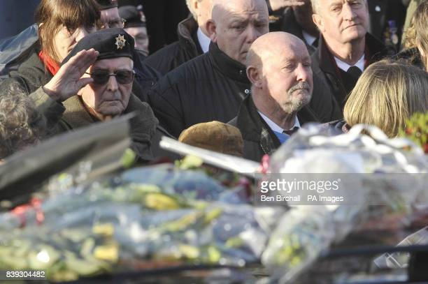 A veteran soldier salutes at a repatriation through the Wiltshire town of Wootton Bassett as the bodies of Rifleman Philip Allen of 2nd Battalion The...