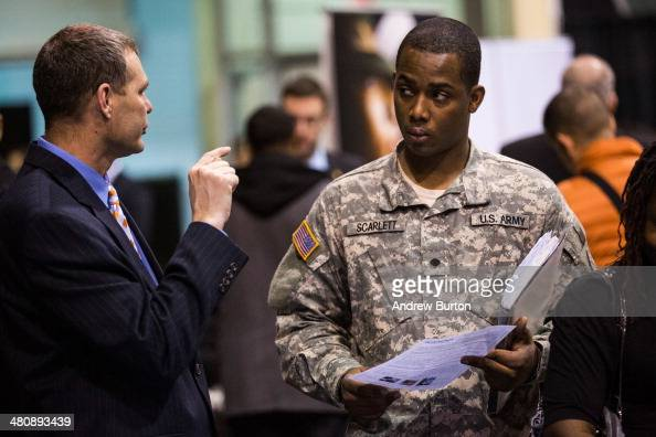 A veteran speaks to a job recruiter at a 'Hiring our Heroes' Job Fair on March 27 2014 in New York City The jobs fair which was put together by the...
