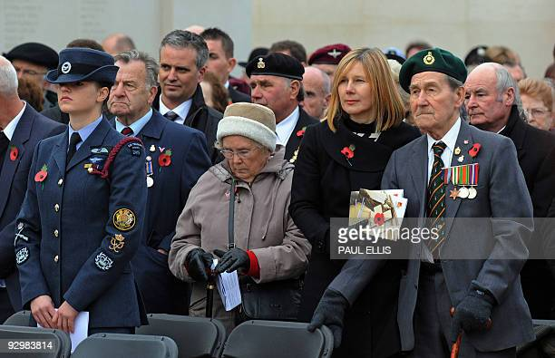 A veteran stands with serving military personnel as Britain's Prince Edward Earl of Wessex lays a poppy wreath at The Armed Forces Memorial at the...
