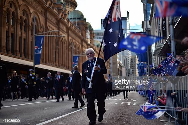 A veteran takes part in the Anzac Day parade along George Street in Sydney on April 25 2015 Record numbers of Australians and New Zealanders turned...
