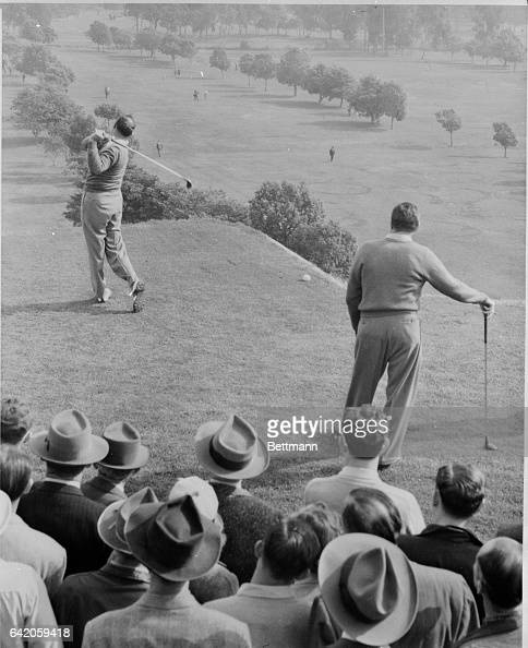 Veteran Vic Ghezzi drives a long one with contender for the play Harold McSpaden looking on at the $13333 Los Angeles Open Golf Tournament at the...