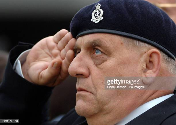 A veteran watches a biplane dropping poppies over the Tyne Cot War Cemetary Passchedaele during a ceremony for WWI Commonwealth soldiers