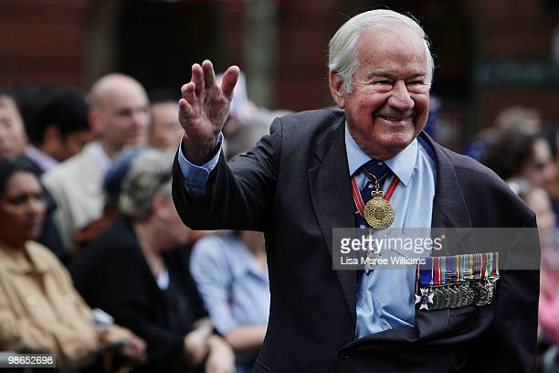 A veteran waves to the crowd along Bathurst Street during the ANZAC Day Parade in the Sydney CBD on April 25 2010 in Sydney Australia Veterans...