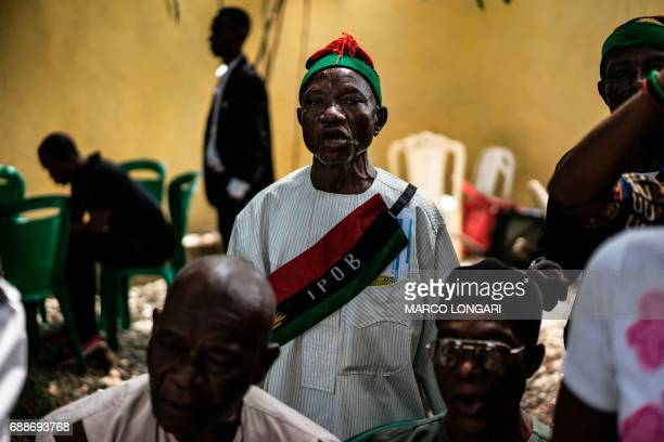 A veteran wearing the insignia of the Indigenous People of Biafra movement looks on during a meeting between veterans of the Nigerian civil war and...