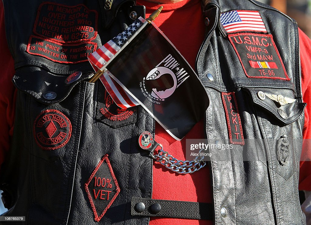 A veteran wears a U.S. and POW-MIA flag together on his vest during a Veterans Day event at the Vietnam Veterans Memorial November 11, 2010 in Washington, DC. The nation's veterans were honored and remembered during the annual Veterans Day.