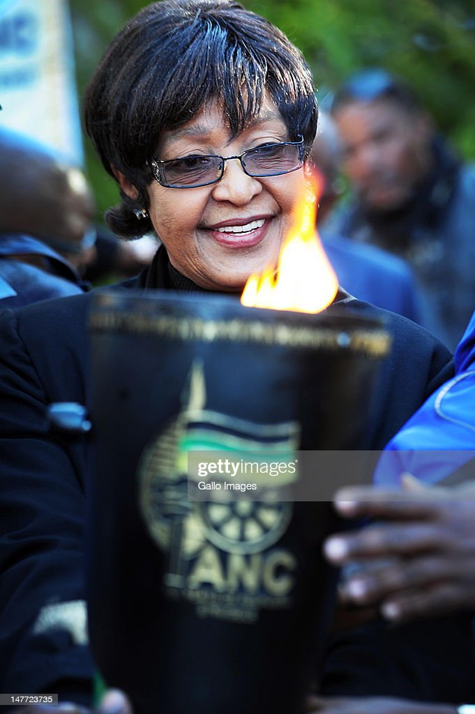 ANC veteran Winnie Madikizela-Mandela receives the ruling party's centenary flame at her home in Orlando, Soweto on June 30, 2012.