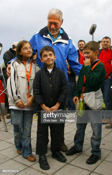 Veteran yachtsman Sir Robin KnoxJohnston says goodbye to his grandchildren Florence 11 Oscar 9 and Xavier 8 before departing in the Velux 5 Oceans...