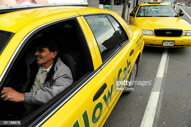 DENVER CO Veteran Yellow Cab taxi driver Jim Aswad waits in his cab for a fare in front of the Crowne Plaza Hotel in downtown Denver Tuesday...