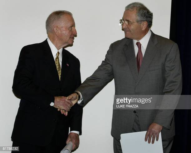 Veterans Affairs Secretary Anthony J Principi congratulates businessman and veterans supporter Ross Perot after Principi released a report of the...