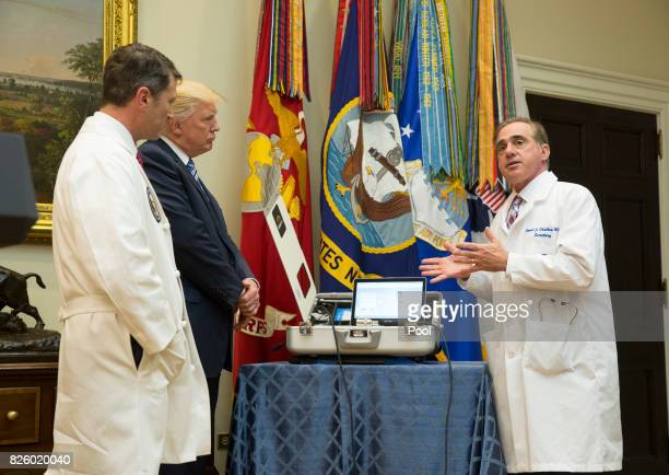 US Veterans Affairs Secretary DrDavid Shulkin explains equipment to White House Physician Dr Ronny L Jackson US President Donald Trump to be used in...