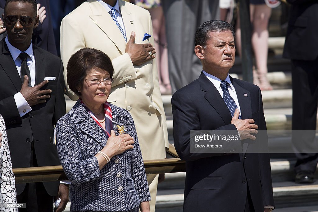 Veterans Affairs Secretary Eric Shinseki and his wife Patricia Shinseki look on during as US President Barack Obama attends a wreath laying ceremony...