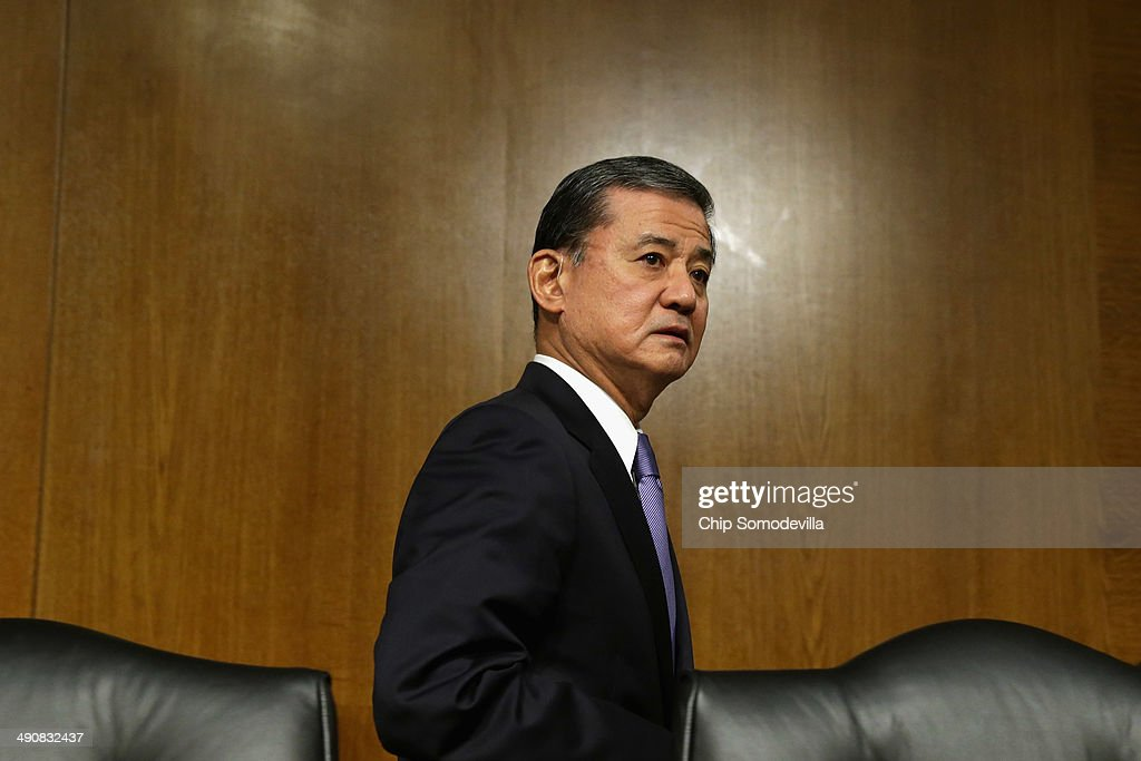S Veterans Affairs Secretary Eric Shinseki reenters the hearing room after testifying to the Senate Veterans' Affairs Committee about wait times...