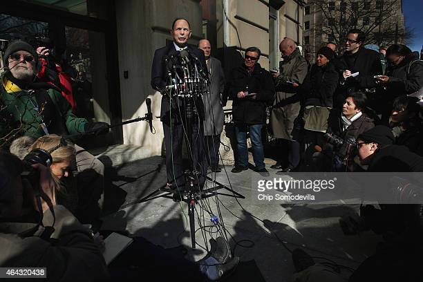 S Veterans Affairs Secretary Robert McDonald delivers a statement and answers reporters' questions outside of his department's headquarters February...
