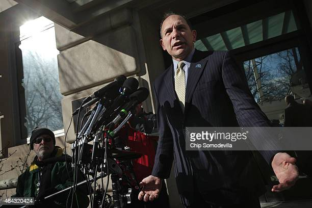 S Veterans Affairs Secretary Robert McDonald talks to reporters outside of his department's headquarters February 24 2015 in Washington DC McDonald...