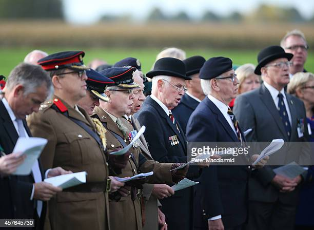 Veterans and currently serving members of the military take part in a reburial ceremony at the Commonwealth War Graves Commission YFarm Cemetery on...