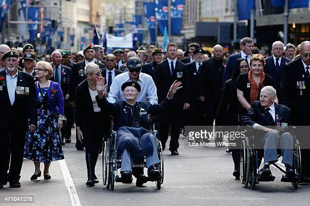 Veterans and family members march along George Street during the Anzac Day Parade on April 25 2015 in Sydney Australia Australians are celebrating...