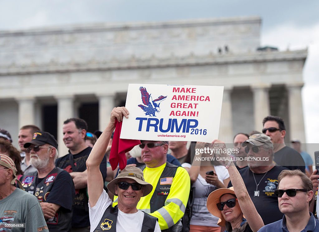 Veterans and supporters lissten to Republican presedential candidite Donald Trump speak during an event at the annual Rolling Thunder 'Ride for Freedom' parade ahead of Memorial Day in Washington, DC, on May 29, 2016. / AFP / Andrew Caballero-Reynolds
