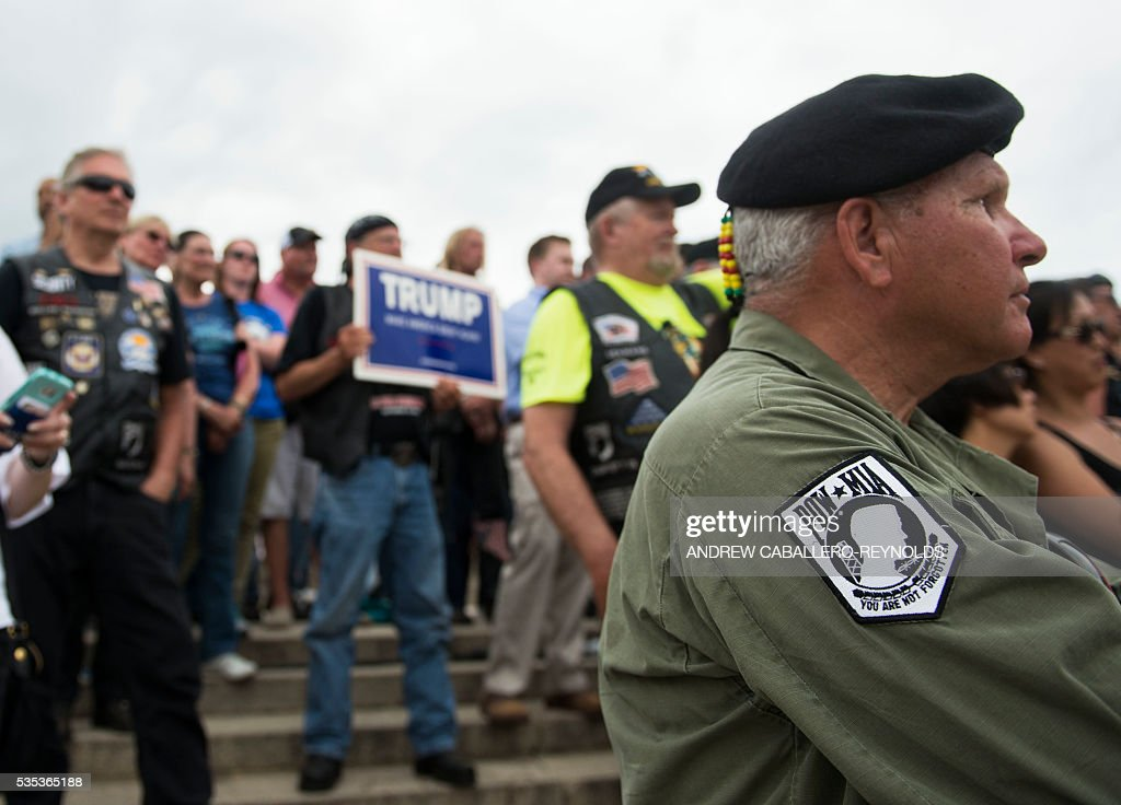 Veterans and supporters listen to Republican presedential candidate Donald Trump speak during an event at the annual Rolling Thunder 'Ride for Freedom' parade ahead of Memorial Day in Washington, DC, on May 29, 2016. / AFP / Andrew Caballero-Reynolds
