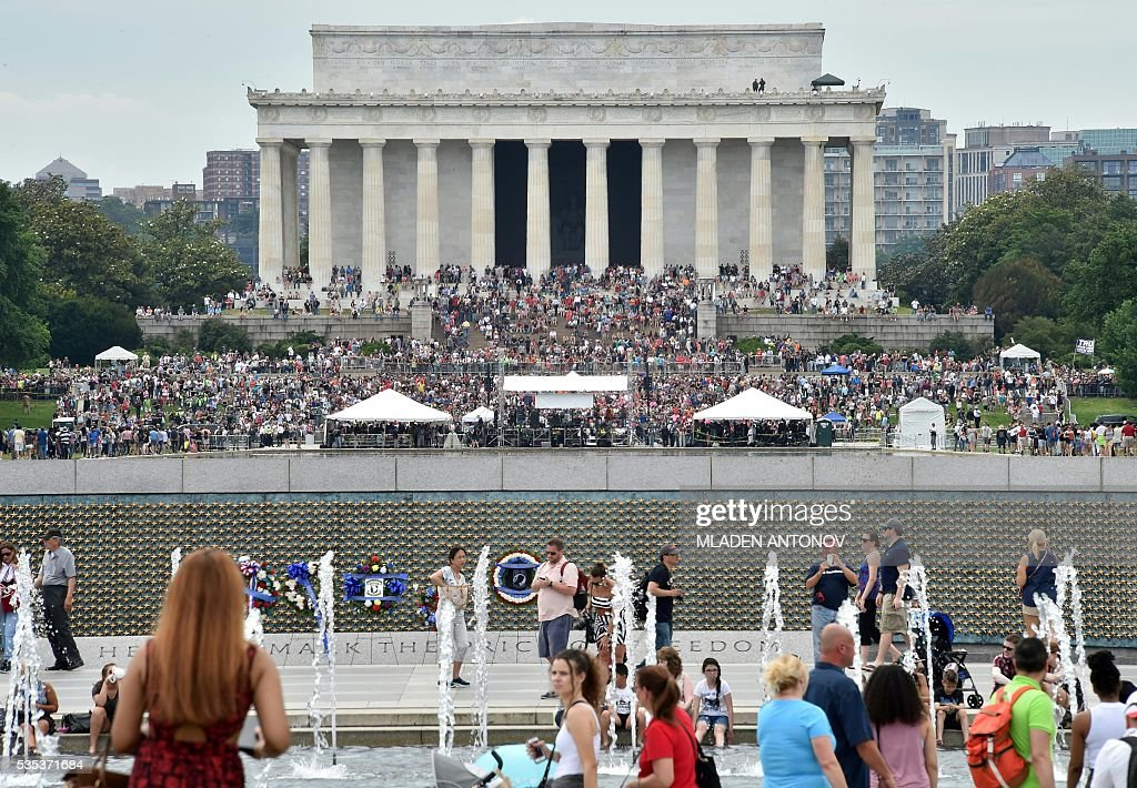 Veterans and supporters listen to Republican presedential candidate Donald Trump speaking during an event at the annual Rolling Thunder 'Ride for Freedom' parade ahead of Memorial Day in Washington, DC, on May 29, 2016. / AFP / MLADEN