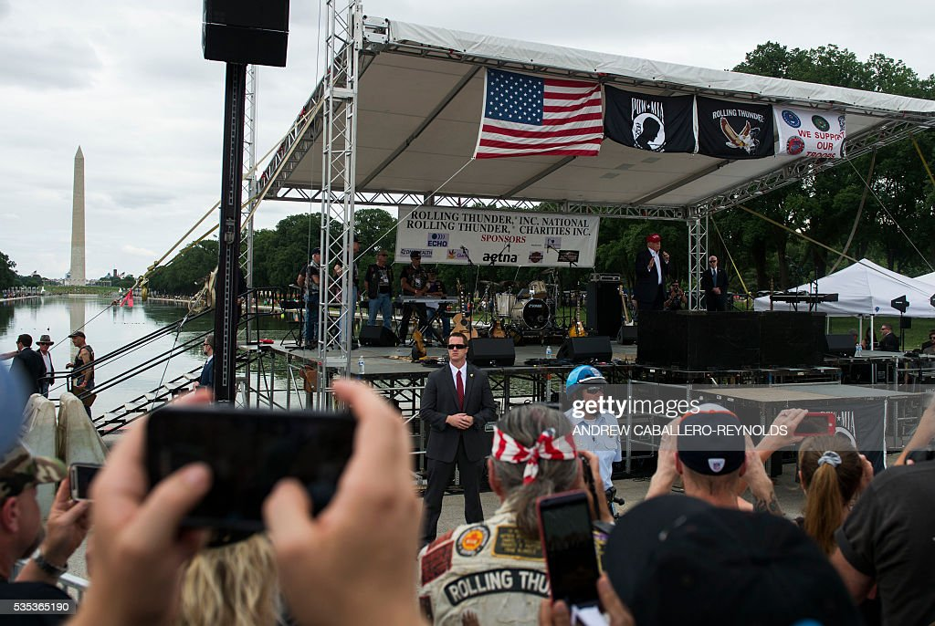 Veterans and supporters listen to Republican presidential candidate Donald Trump speak during an event at the annual Rolling Thunder 'Ride for Freedom' parade ahead of Memorial Day in Washington, DC, on May 29, 2016. / AFP / Andrew Caballero-Reynolds