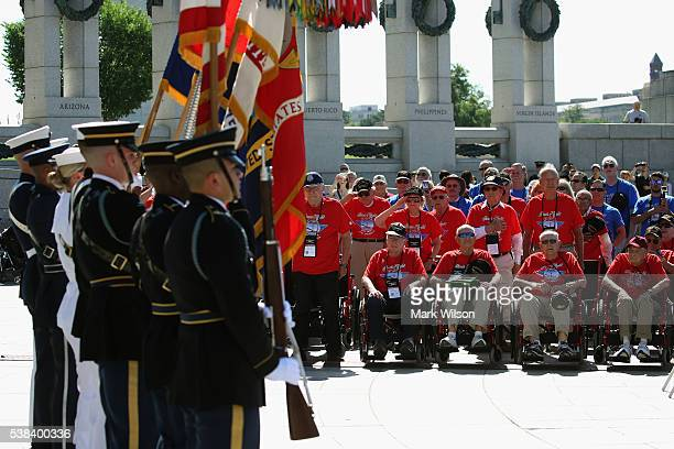 Veterans attend a DDay anniversary wreath laying ceremony at the National World War II Memorial on June 6 2016 in Washington DC Today marks the the...