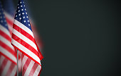 Veterans day concept of USA flag on green background