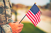 Veteran's Day in America. Soldier with American Flag