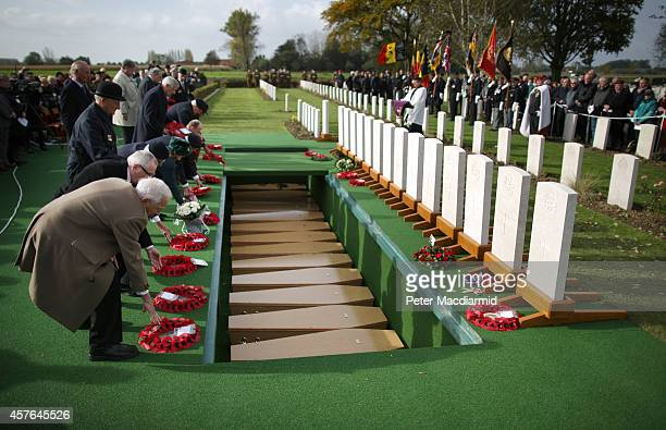 Veterans lay wreaths next to coffins containing the remains of 15 British World War One soldiers during a reburial ceremony at the Commonwealth War...
