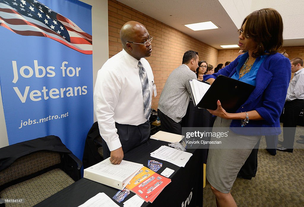Veterans listen to a job recruiter with Metro during a jobs fair for veterans called 'Serving Those Who Have Served' on the campus of University of Southern California on March 20, 2013 in Los Angeles, California. California's unemployment rate tied with Rhode Island's for highest in U.S. at 9.8 percent.