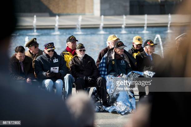 WWII veterans look on as the Friends of the National World War II Memorial and the National Park Service commemorate Pearl Harbor Remembrance Day on...